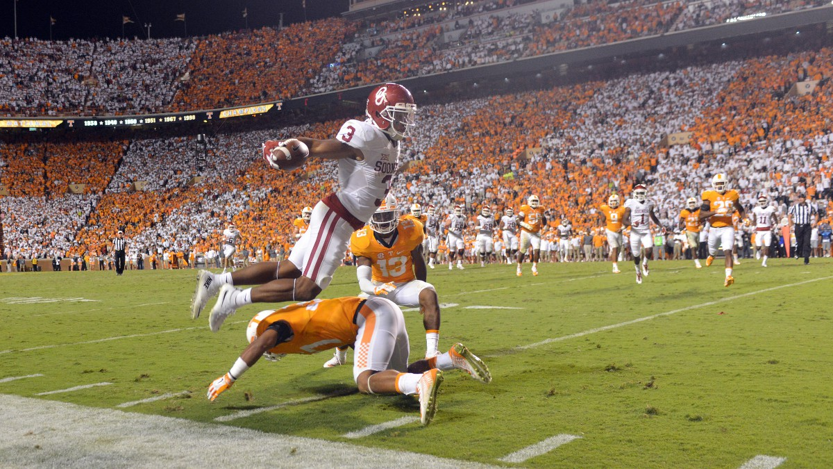 Wide receiver Sterling Shepard of the Oklahoma Sooners jumps over safety Brian Randolph of the Tennessee Volunteers.