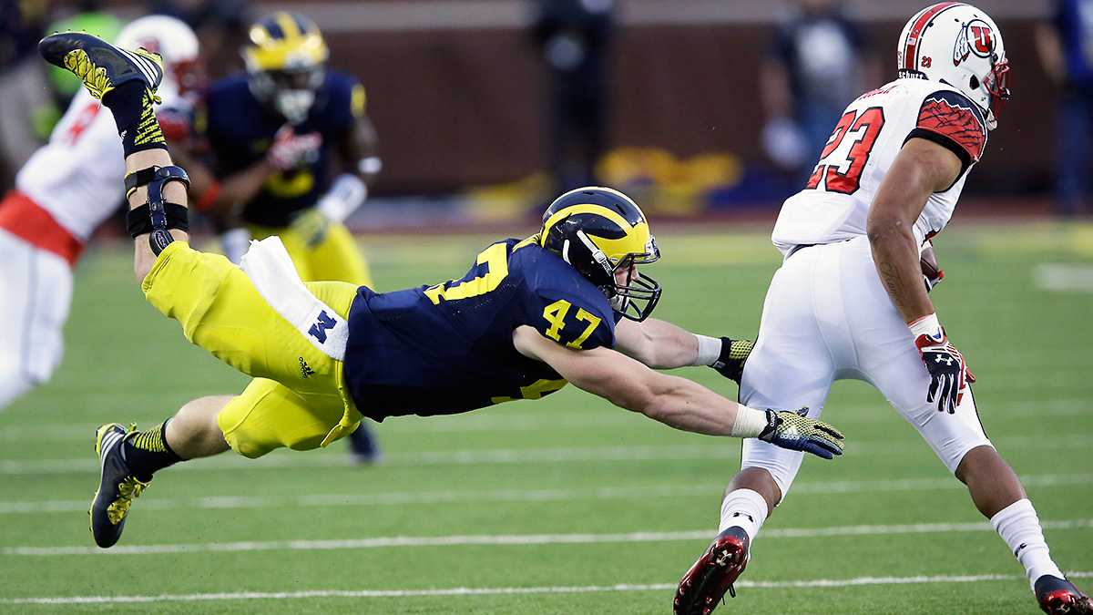 Devontae Booker and the Utes opened the season with a 24-17 win over a Michigan program that has since gone 3-0.