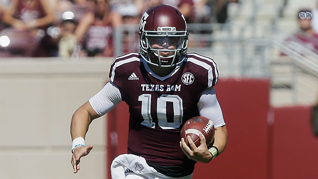 Kyle Allen runs with the ball against Nevada on September 19.