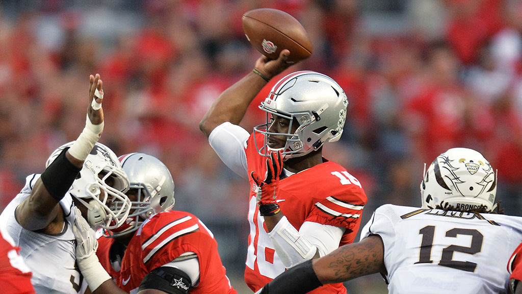 COLUMBUS, OH - SEPTEMBER 26: Quarterback J.T. Barrett #16 of the Ohio State Buckeyes passes in the fourth quarter against the Western Michigan Broncos at Ohio Stadium on September 26, 2015 in Columbus, Ohio. Ohio State defeated Western Michigan 38-12. (Photo by Jamie Sabau/Getty Images)