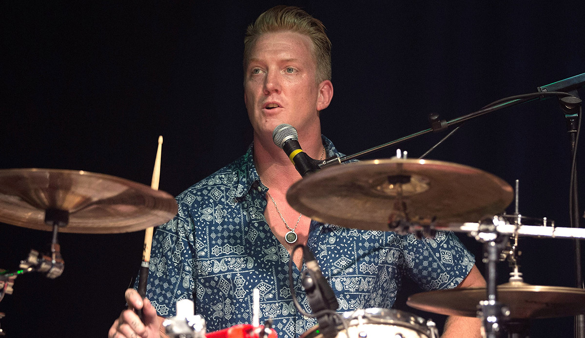 Queens of the Stone Age frontman Josh Homme plays drums for Eagles of Death Metal.