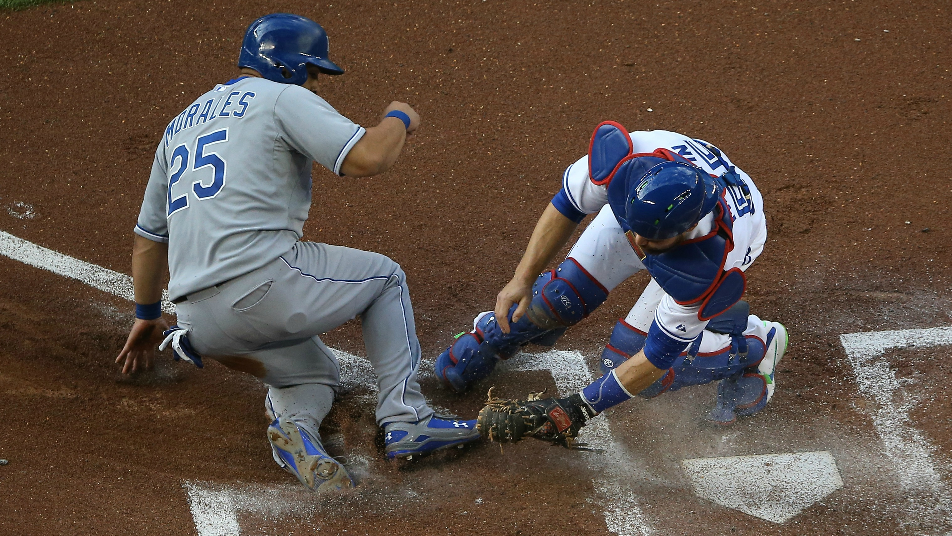 TORONTO, CANADA - JULY 31: Kendrys Morales #25 of the Kansas City Royals evades the tag of Russell Martin #55 of the Toronto Blue Jays in the first inning during MLB game action on July 31, 2015 at Rogers Centre in Toronto, Ontario, Canada. (Photo by Tom Szczerbowski/Getty Images) *** Local Caption *** Kendrys Morales; Russell Martin