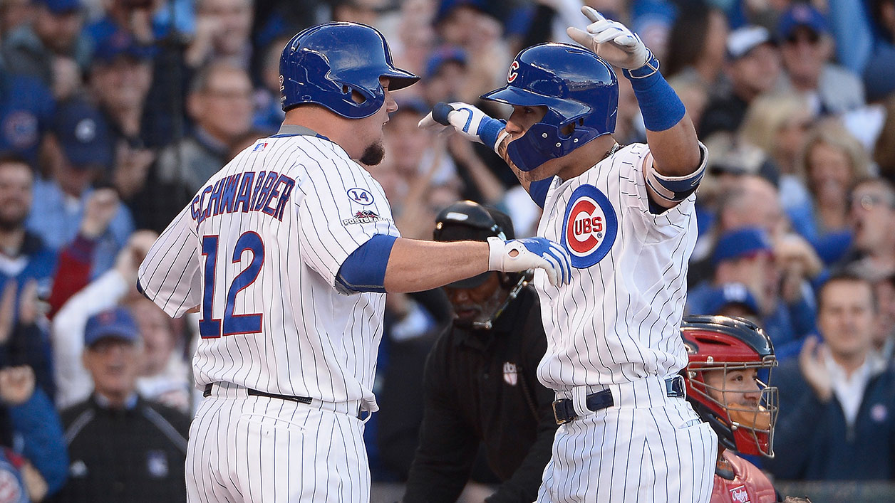 Kyle Schwarber and Javier Baez celebrate after Baez's three-run homer in the second inning.
