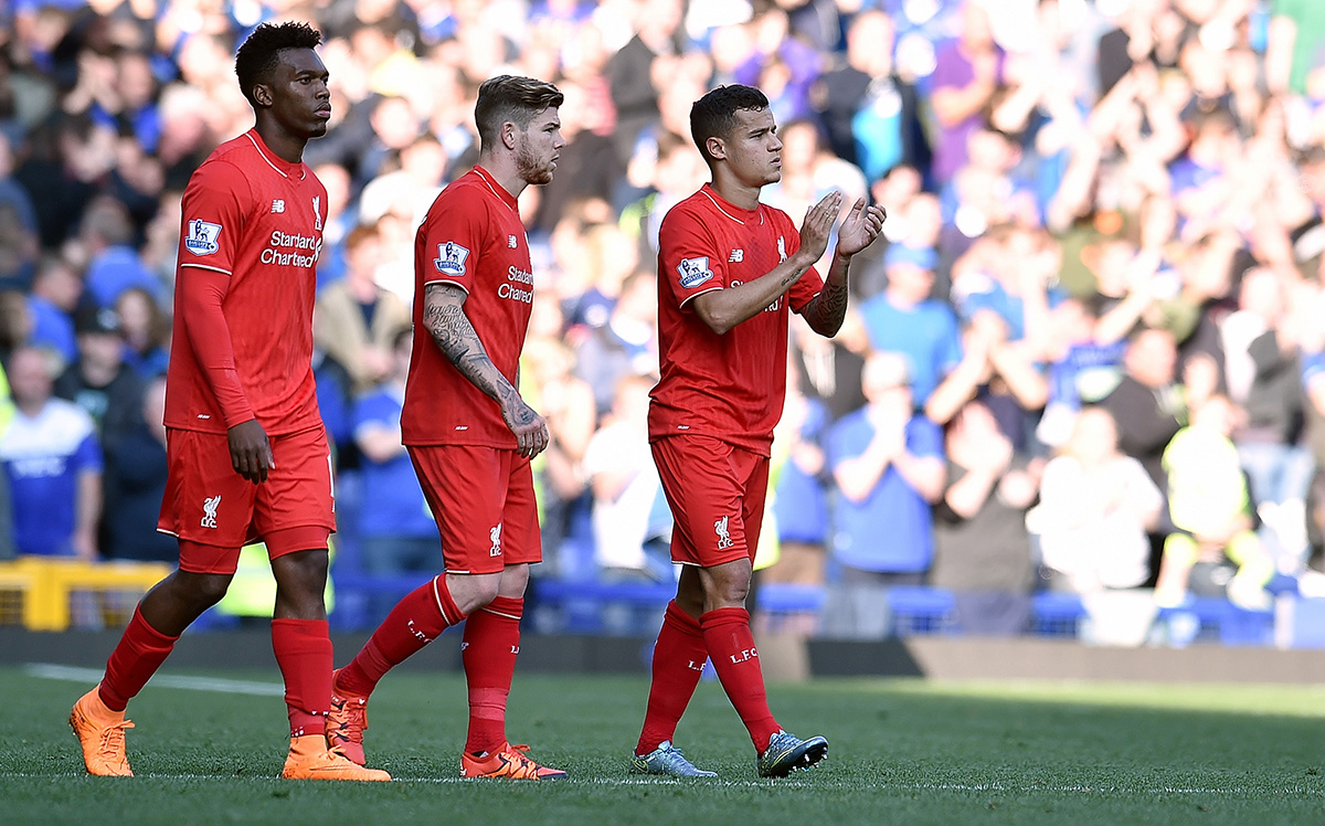 Daniel Sturridge, Jordan Henderson, and Philippe Coutinho of Liverpool.