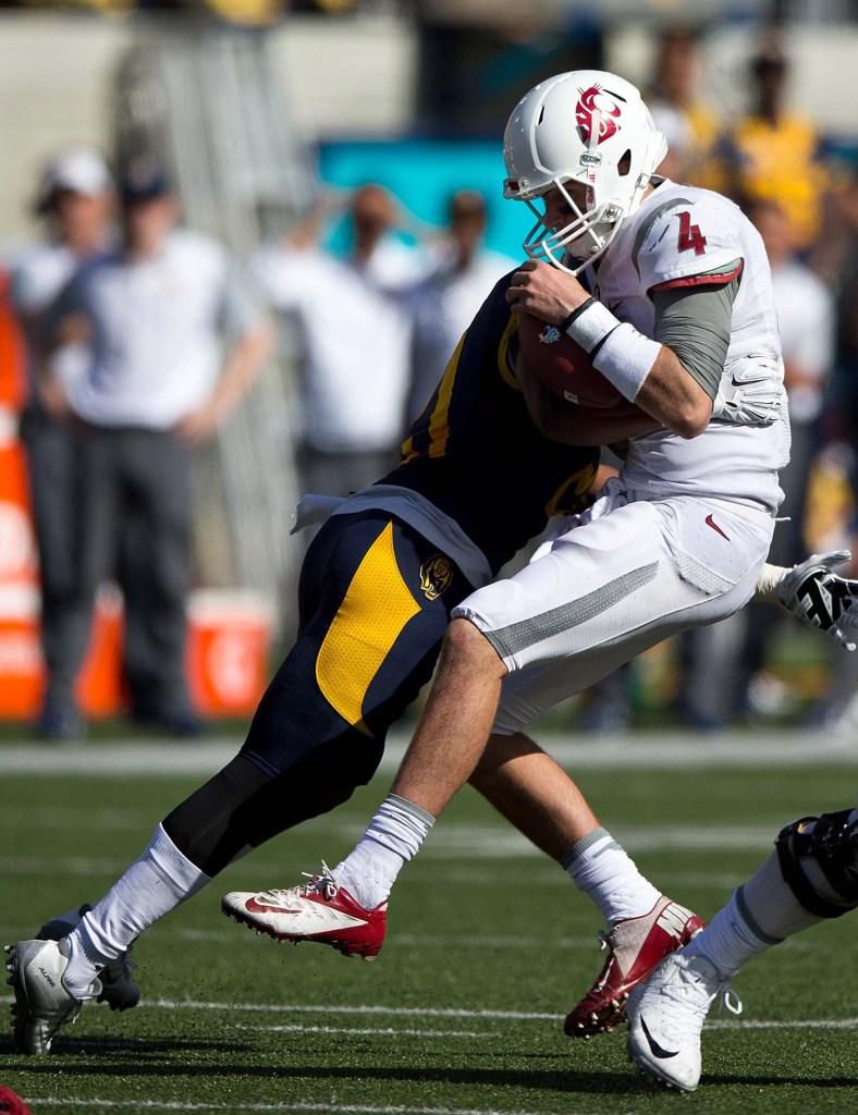 Stefan McClure takes down quarterback Luke Falk of the Washington State Cougars.